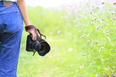 Photographer holding DSLR camera in his hands, Travel lifestyle vacations concept royalty free stock photography