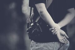 Photographer holding hands behind  Royalty Free Stock Photo