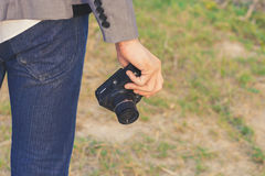 Photographer holding his camera Royalty Free Stock Images