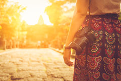 Photographer holding his camera on sunset. Royalty Free Stock Photos