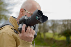 Photographer holding his photo camera Royalty Free Stock Image
