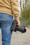 Photographer holding his photo camera Royalty Free Stock Photo
