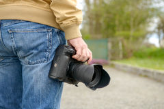 Photographer holding his photo camera Stock Images