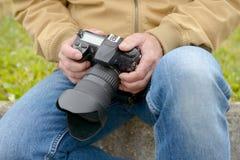 Photographer holding his photo camera Stock Photography