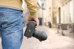 Photographer holding his photo camera Stock Image