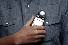 Photographer. Holding a light meter Stock Image