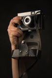 Photographer holding a old Camera in the Hand Stock Images