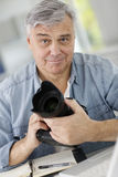 Photographer holding reflex camera Stock Photography