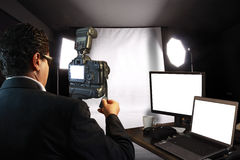 Photographer In Studio Stock Photography