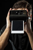 Photographer with a instant camera Royalty Free Stock Images