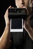 Photographer with a instant camera Stock Photo