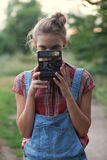 Photographer and instant camera Royalty Free Stock Photos