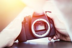 Free Photographer Is Using A Professional Camera, Open Sensor And Sunlight Stock Photos - 145082853