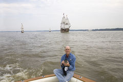 Photographer Joe Sohm. Posing on chase boat with The Susan Constant, Godspeed and Discovery ships, re-creations of the three ships that brought English Stock Images