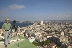 Photographer Joe Sohm with panoramic camera taking picture of Havana, Cuba Stock Photos