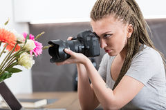 Photographer in a kitchen training and checking Royalty Free Stock Image
