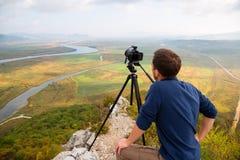 Photographer landscape on the camera shoots Stock Photography