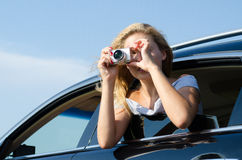 Photographer leaning out of car window Royalty Free Stock Photo