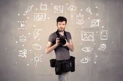 Photographer learning to use camera. An amateur hobby photographer learning to use a professional digital camera with camera settings icons on the background royalty free stock photos