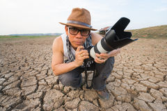 Photographer with long telephoto lens Royalty Free Stock Photography
