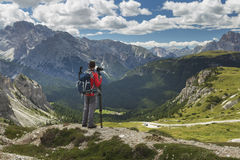 Photographer looking away in Dolomite Alps Mountains Stock Image