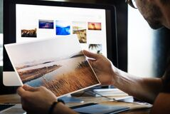 Photographer looking at prints Stock Image