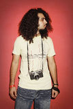 Photographer looking sidewise with beautiful long curly hair hol Royalty Free Stock Image