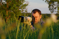 Photographer looks at camera Royalty Free Stock Photography