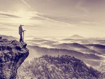 Photographer looks into the landscape and listen the silence. Man prepare camera to takes photos. Photographer looks into the landscape and listen the silence Stock Photography