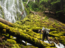 Photographer in Lush Waterfall Royalty Free Stock Images