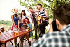 Photographer make photo of birthday girl with guests in nature stock image