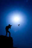 Photographer make a shot of a hummingbird. On the top of hill Stock Image