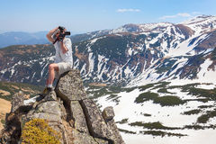 Photographer makes the photo in the mountains Stock Images