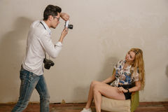 A photographer is making a photo of a blonde model Stock Image