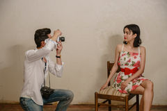 A photographer is making a photo of a cute brunette model Stock Image