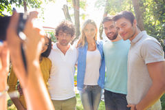Photographer making photo of a group friends Stock Photography