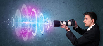 Photographer making photos with powerful light beam Royalty Free Stock Photos