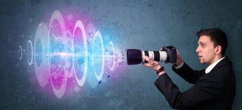 Photographer making photos with powerful light beam Royalty Free Stock Photos