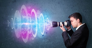 Photographer making photos with powerful light beam Stock Image