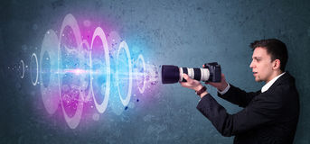 Photographer making photos with powerful light beam Royalty Free Stock Images