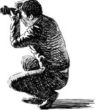 Photographer making photos. Vector drawing of a photographer making photos Royalty Free Stock Photo