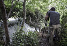 Photographer is making picture of waterfalls Royalty Free Stock Image
