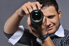 Photographer making a shot. Picture of a Photographer making a shot royalty free stock photo