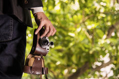 Photographer man in the forest. With abstract background Stock Photography