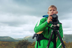 Photographer man in mountain stock images