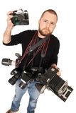 Photographer with many cameras Stock Photo