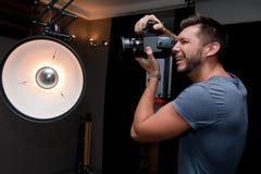 Photographer with a medium format camera Royalty Free Stock Photos