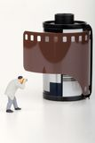 Photographer miniature and Photographic film roll Stock Photo