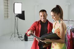 Photographer with a model. Royalty Free Stock Photography