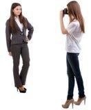 Photographer with a model. Photographer with a model isolated on white background Stock Photography